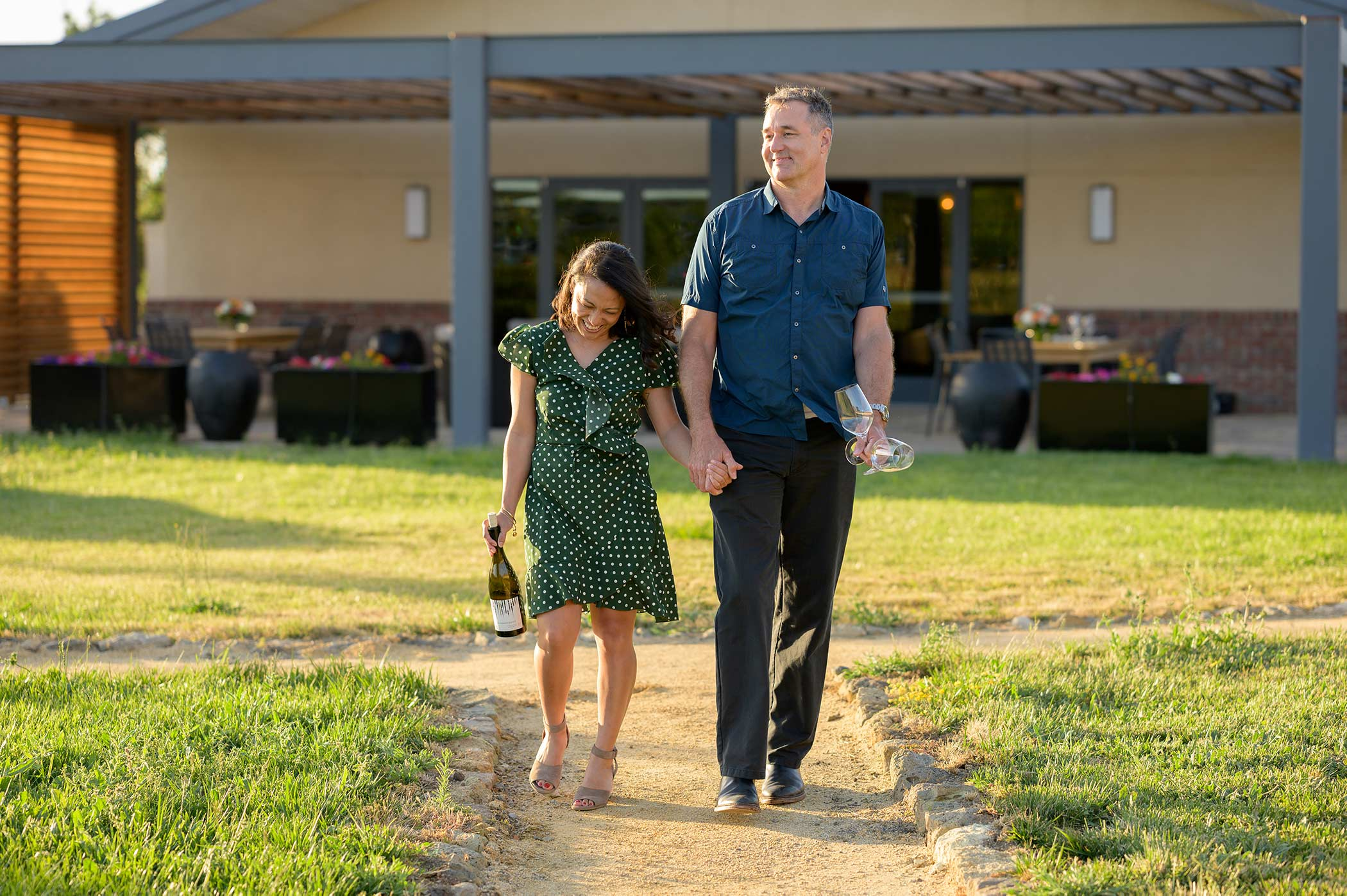 A couple taking a stroll on the RD Winery property