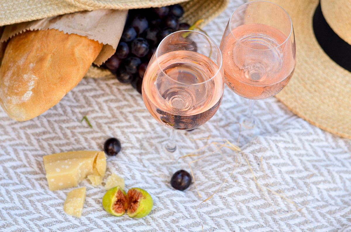 A relaxing summer picnic with two glasses of rosé