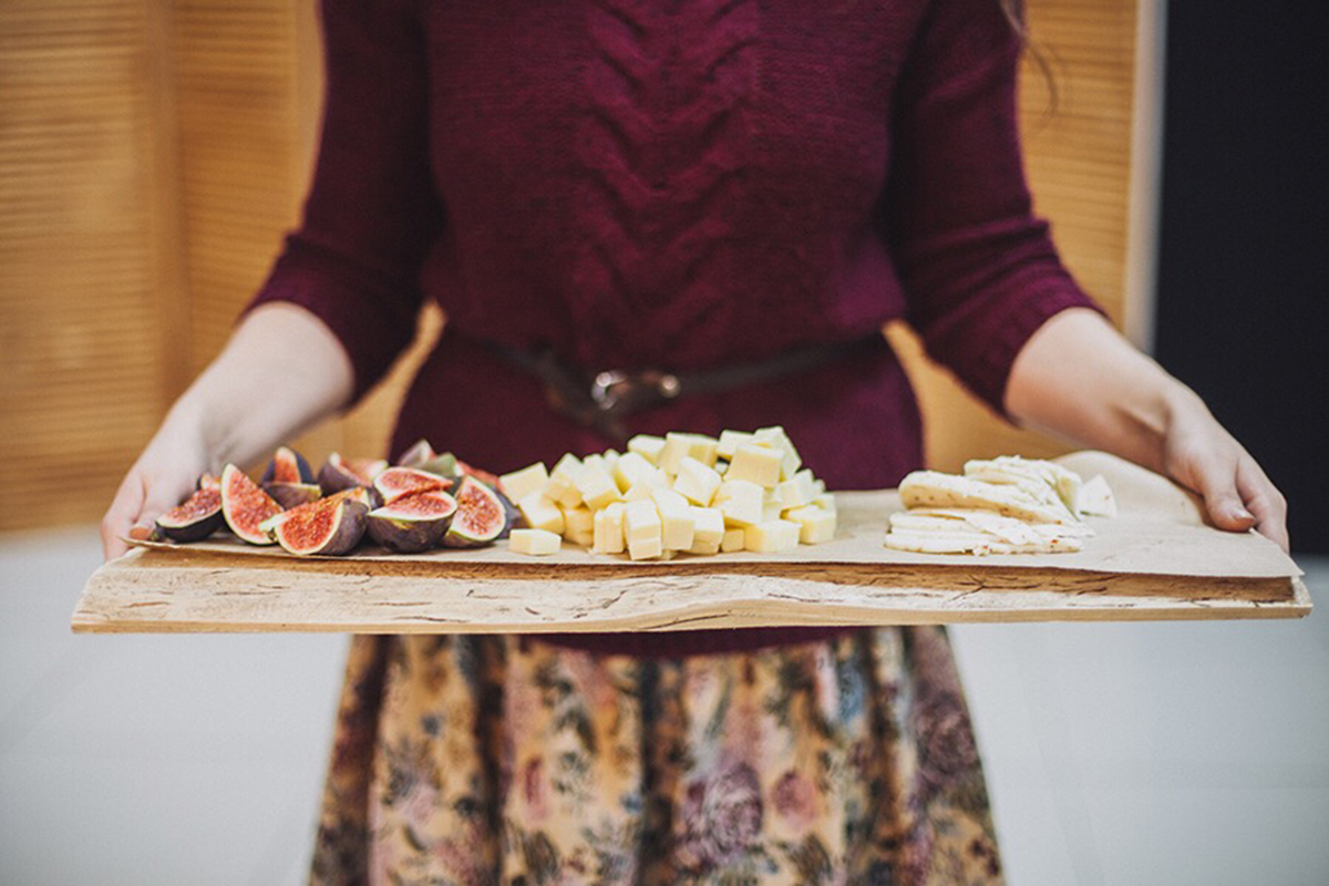 Woman serving a cheese platter