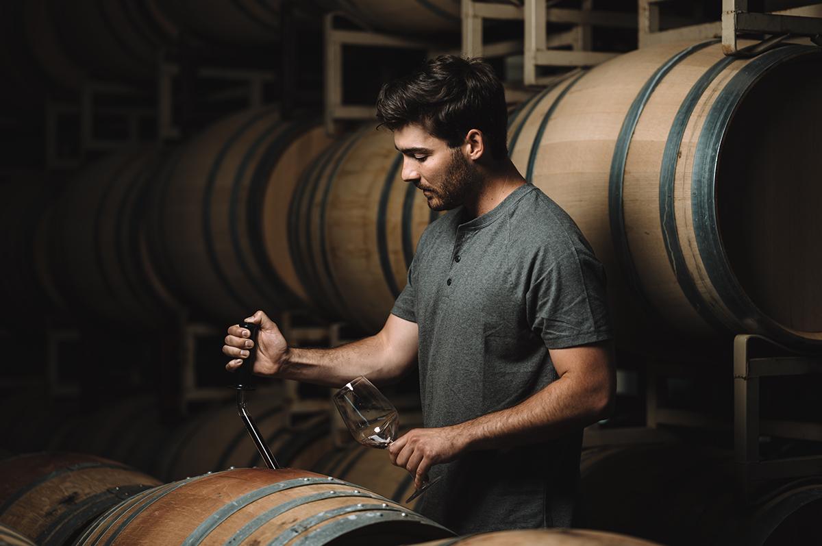 Assistant Winemaker Connor Bockman Sampling Barrels