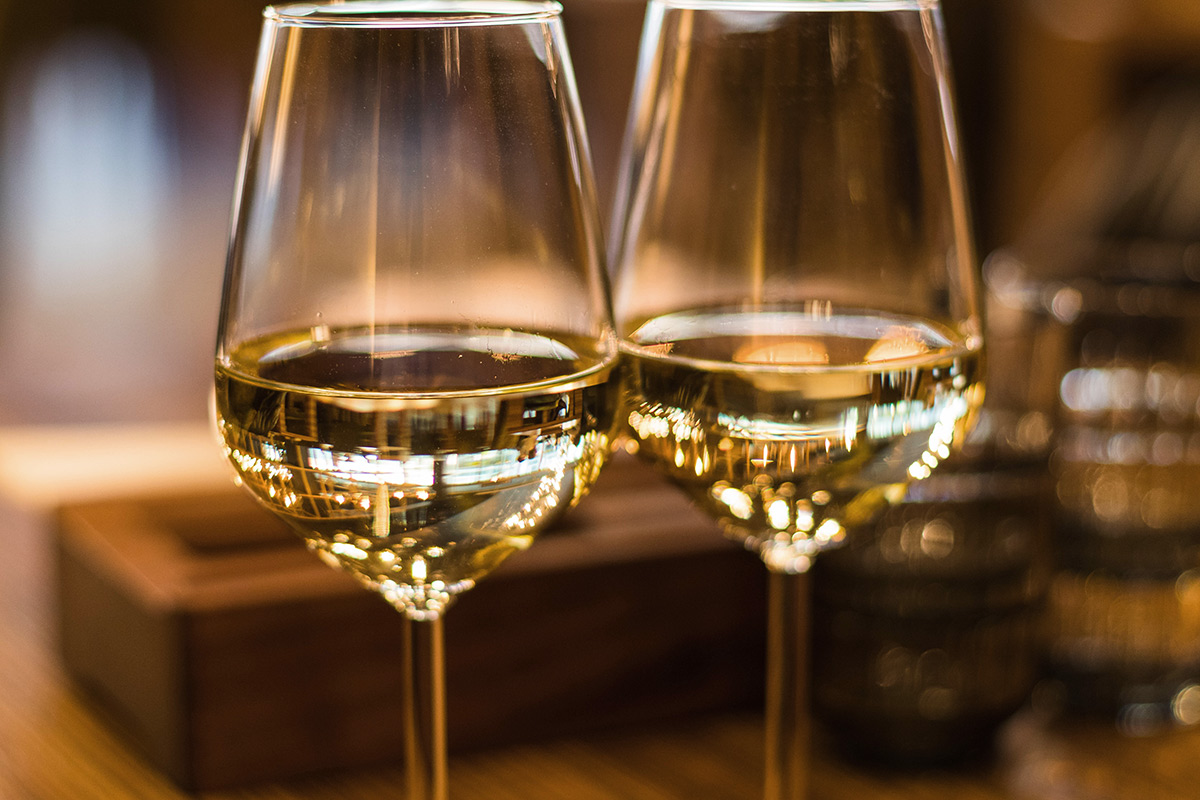 Two white wine glasses close up