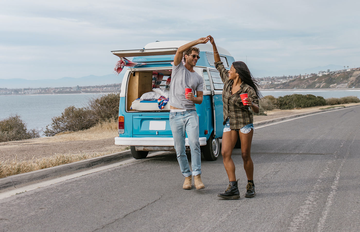 Man and woman taking a break from a road trip.