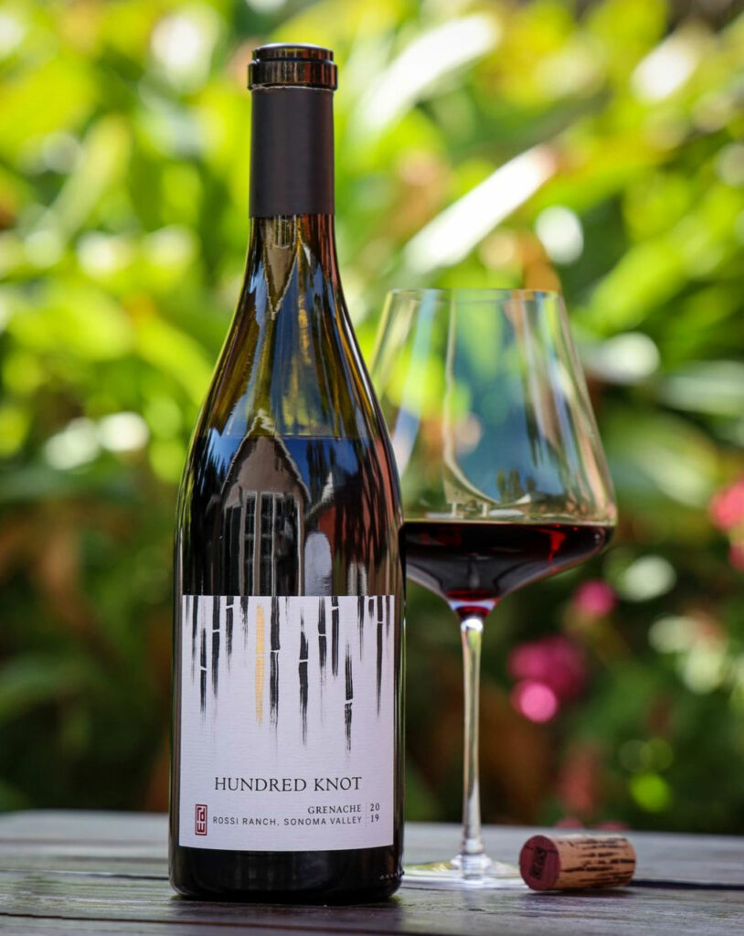 2019 RD Winery Hundred Knot Grenache on a table with a glass.