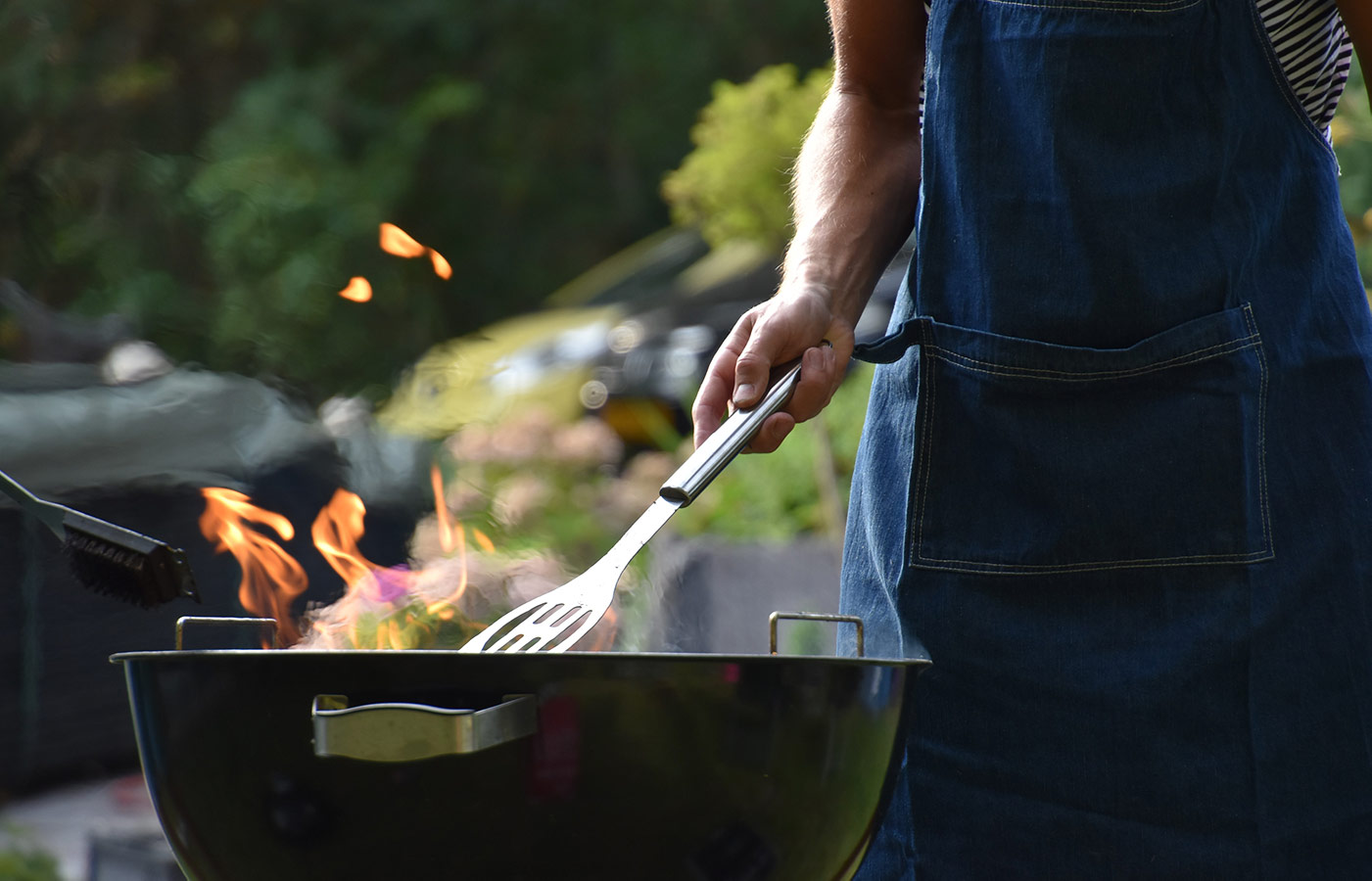 Man grilling on a BBQ.