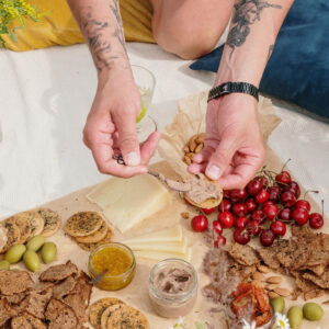 Hands spreading pate on a cracker