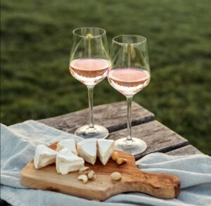 Two glasses of rosé with cheese board